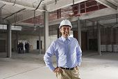 pic of headgear  - Portrait of a smiling male manager at building site - JPG