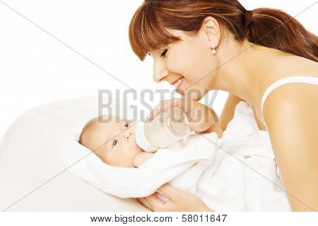 Feeding Baby. Newborn Eating Milk From Bottle.
