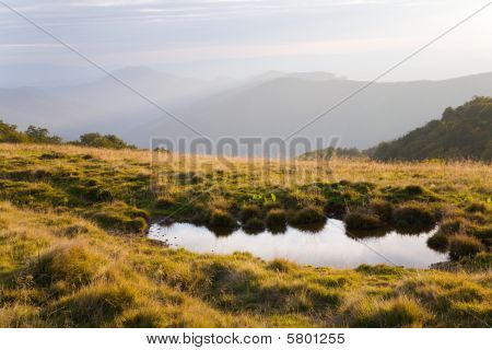 Reflection In Autumn Mountain