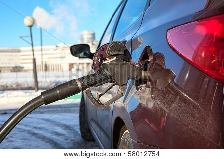 Close Up View Of Car Refuel In Gas Station
