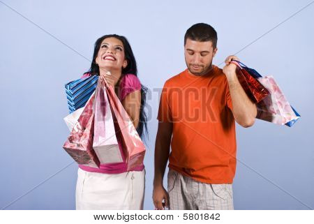 Happy And Sad People At Shopping