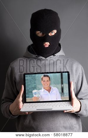 Masked Man With Computer With Picture Of Woman Giving Money