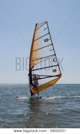 Windsurfer Among The Waves