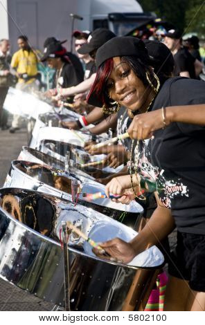 Woman playing steel drums at a steel-drum festival.
