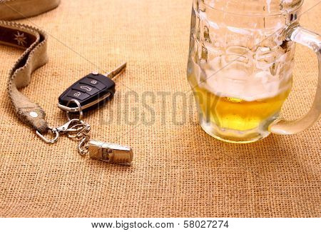 Car Key With A Tilted Toy Car And Beer Mug