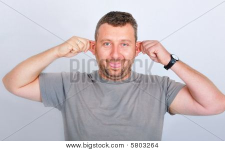 Young Funny Man Holding His Ears