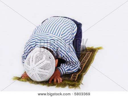 Little Muslim Boy Is Praying On Traditional Way