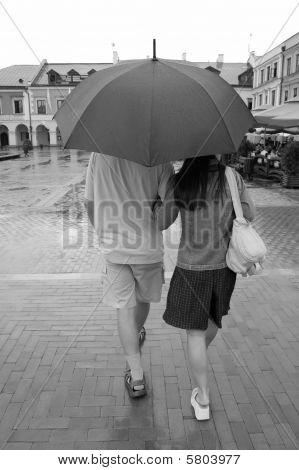Couple Walking In Rain