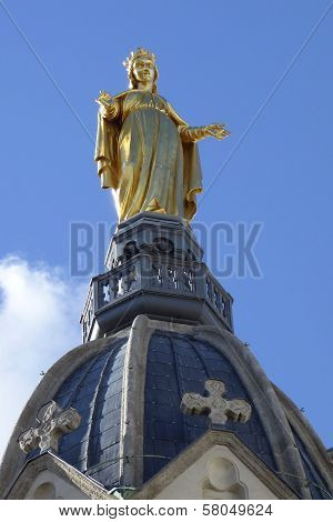 Statue of Mary on top of Chapel de la Vierge at Basilica of Notre Dame de Fourviere in Lyon, France