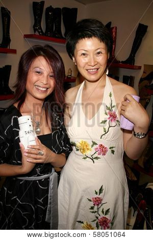 Serena Guam and Lisa Gao  at the Dans Sara, Leezee Fabulous Shoes and Swing Cologne Gifting Suite. LA Fashion Market, Los Angeles, CA. 06-13-08