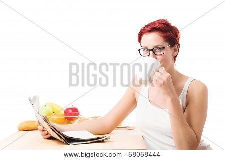 Young Woman Drinking Coffee Reading Newspaper