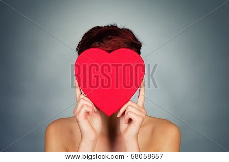 Hiding Face Behind Red Heart