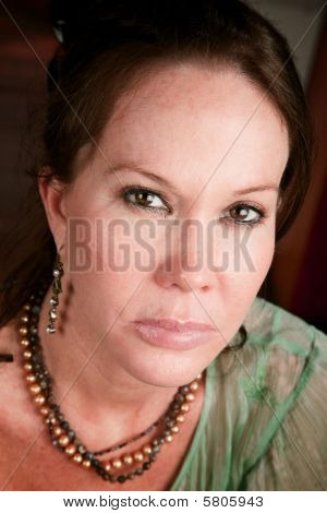 Pretty Woman With Stern Expression