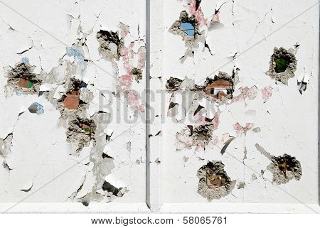 Concrete Wall With Holes In Several Places