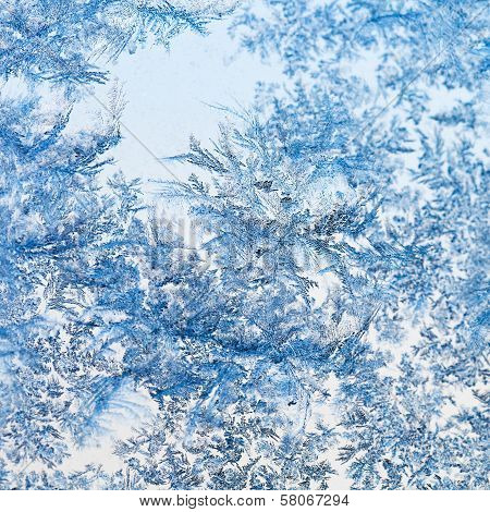 Snowflakes And Frost Pattern On Glass Close Up