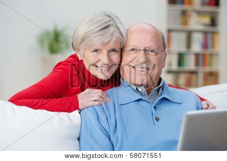 Friendly Senior Couple With Happy Contented Smiles