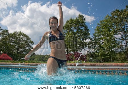 A Woman Jumping Out Of A Pool