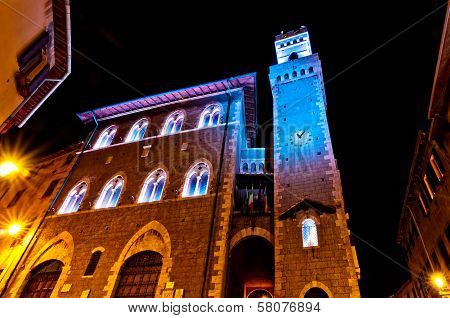 Night view of downtown with enlightened Town Hall in Piombino, Italy