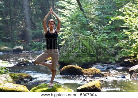 Woman Doing Yoga Near River