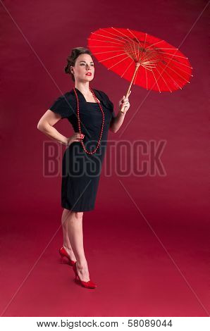 Pinup Girl In Black Dress Haughty With Red Parasol