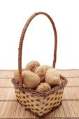 pic of vulva  - Basket of brown walnuts on white background - JPG