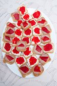 pic of oblong  - Red caviar sandwiches on white festive table on a white oblong plate - JPG