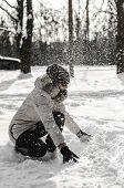 foto of ruddy-faced  - Funny teenager girl playing in white snow - JPG