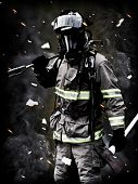 image of ember  - A firefighter Poses after a long fire fight with smoke debris and embers in the background - JPG