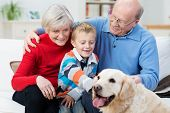 Grandparents With Their Grandson And Pet Retriever