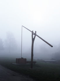 stock photo of shadoof  - Traditional hungarian well on a misty day - JPG
