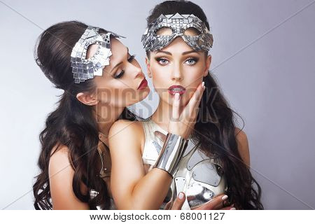 Imagination. Pair Of Styled Women In Futuristic Silver Glasses