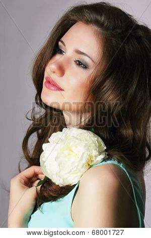 Femininity. Sincere Brunette With White Peony