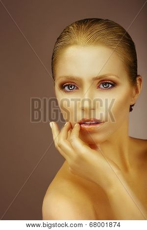 Pure Beauty. Gilded Woman's Face