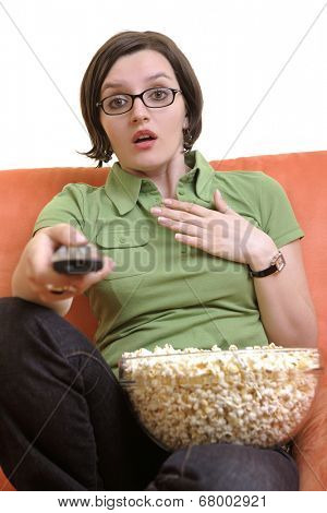 young woman eat popcorn, watching movies and eat popcorn at modern home living room  isolated on white background