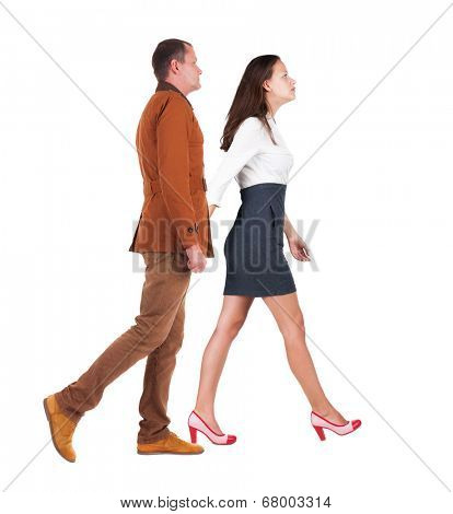 Back view of walking business team. Going young couple (man and woman). Rear view people collection. backside view of person. Isolated over white background