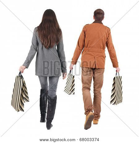 walking couple with shopping bag. rear view. Isolated over white.