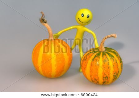 Conceptual Photo Of The Person With Two Pumpkins