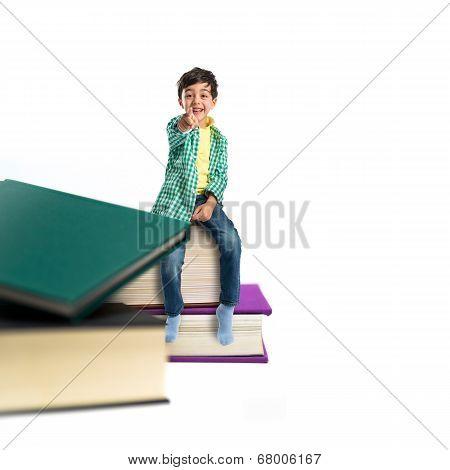 Kid On Several Books Over White Background