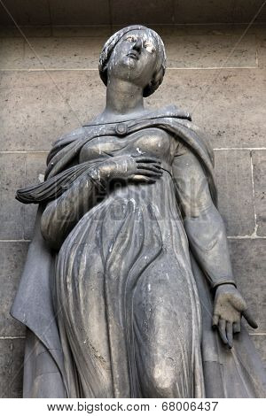 PARIS, FRANCE - NOV 09, 2012: Saint Christina, architectural details of Eglise de la Madeleine. Madeleine Church was designed in its present form as a temple to the glory of Napoleon's army.