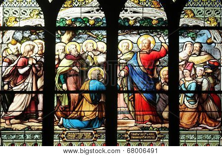 PARIS,FRANCE - NOV 11,2012:Jesus gives Peter the keys to the Kingdom, stained glass.The Church of St Severin is Catholic church in the Latin Quarter. It is one of the oldest churches on the Left Bank.