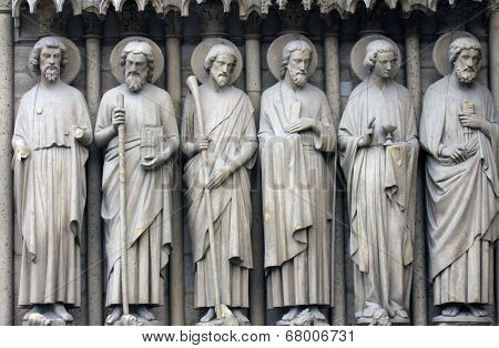 PARIS, FRANCE - NOV 05,2012: Bartholomew, Simon, James the Less, Andrew, John, and Peter, architectural detail of Notre Dame cathedral.Detail of central portal, depicting the Last Judgment (c.1230).