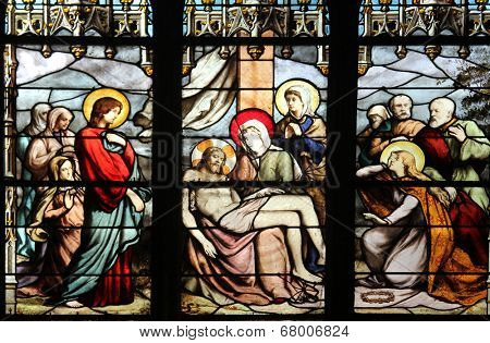 PARIS, FRANCE - NOV 11, 2012: Pieta, stained glass. The Church of St Severin is Catholic church in the Latin Quarter. It is one of the oldest churches on the Left Bank.