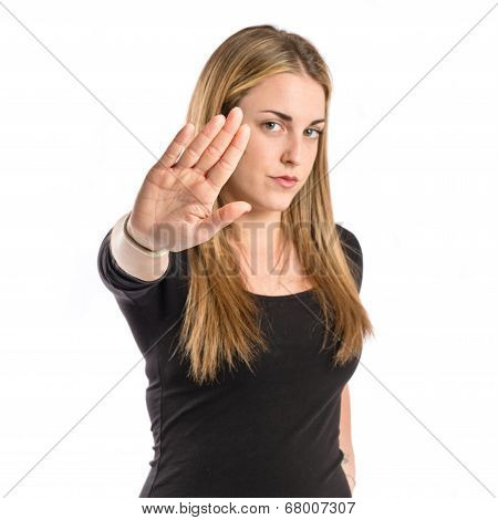 Blonde Girl Making Stop Sign Over White Background