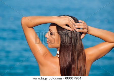 Girl posing on sea background