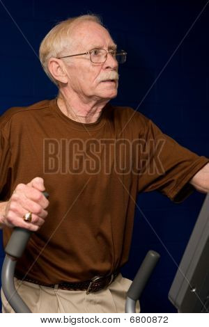 Senior Man On Elliptical Machine