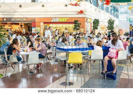 People Eating At Subway Fast Food Restaurant