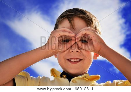 Smiling Boy Did Fingers Like Binoculars