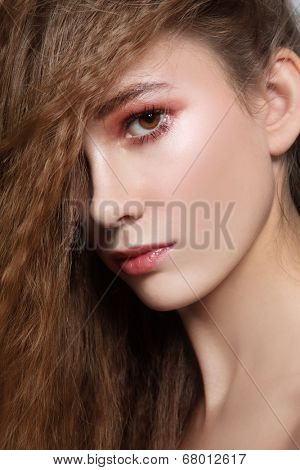 Portrait of beautiful teen girl with long hair and dewy skin