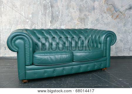 Green Leather Sofa In A Shabby Room