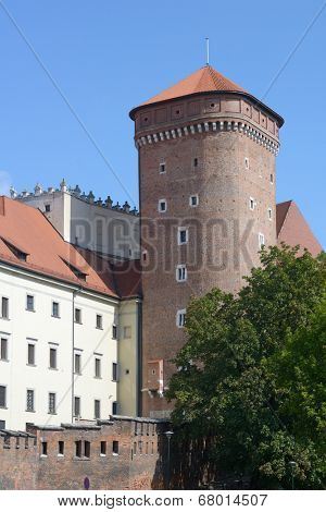 KRAKOW, POLAND - SEPTEMBER 15, 2013: Senator tower of Wawel royal castle in an autumn day. The tower was built in the mid-fifteenth century, and later restored several times